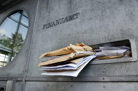 Crowded mailbox at the Inland Revenue tax return deadline
