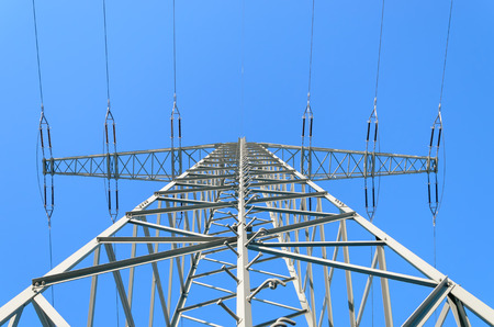 Electricity Pylon shot upwards against clear blue winter sky Imagens