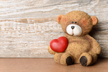 heart under: Little bear with heart under his arm as Valentine\ Stock Photo