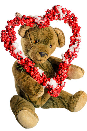 teddy wreath: Teddy Bear with heart-shaped wreath of red berries as a greeting for Valentine