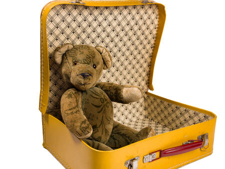 antique suitcase: Antique Teddy bear sitting in a yellow suitcase wants to travel