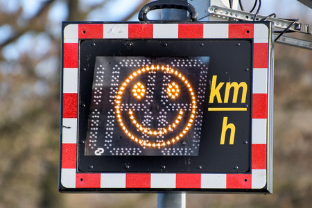 Speed monitoring with smiley on the display Standard-Bild