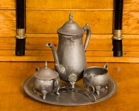 service desk: Antique tea service on an antique cherry wood desk