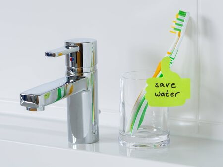 washbowl: Reminder to save water in the bathroom. Detail shot of the washbowl. Stock Photo