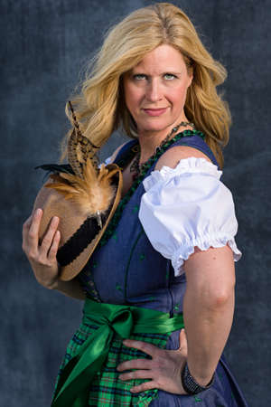 pinafore: Beautiful Bavarian Woman with long blond hair in traditional clothing - ready for Oktoberfest, Series 521 Stock Photo