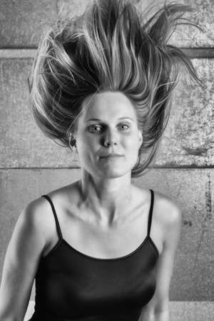b w: BW Portrait of a Woman with an unusual spiky hairstyle Stock Photo
