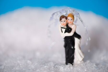 snow man party: Groom carrying his bride through the snow.