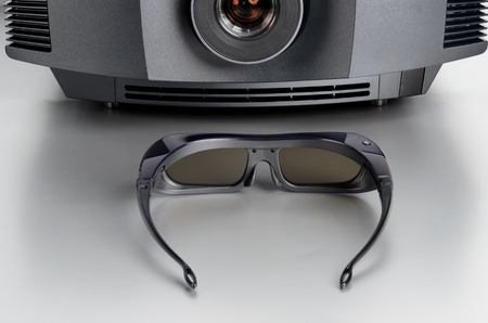 Front view of a home cinema projector with 3D-glasses.