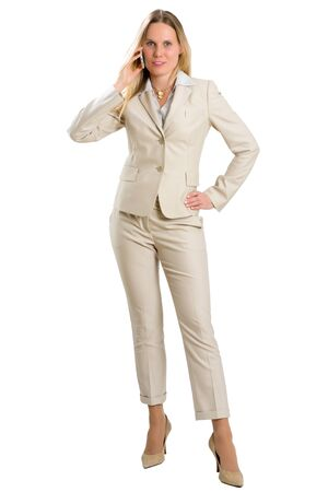 Attractive Caucasian woman in business suit having a phone call with her smartphone, isolated on white.