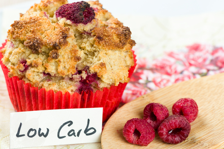 Raspberry cupcake on diet: sweets with low carb cooking.