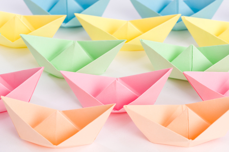 fleet: Overwhelming fleet of origami paper ships passing by Stock Photo