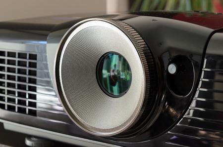 Close up on the huge lens of a black home cinema projector. Stok Fotoğraf - 52910888