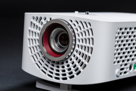 lightweight: Stylish mini home cinema LED projector, lightweight tech gadget close up Stock Photo