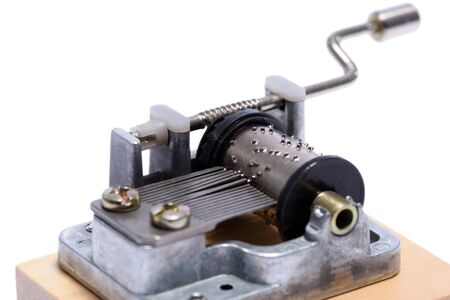 Mechanical music box on white background. Reklamní fotografie