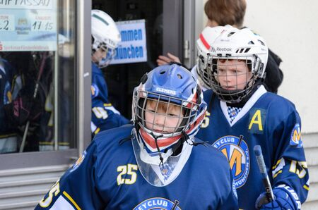 about age: Fuerstenfeldbruck, Bavaria, Germany - 06. February 2016: German Kids playing ice hockey. Age is about 10 years. Teams moving to the stadium.