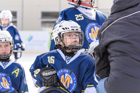 age 10: Fuerstenfeldbruck, Bavaria, Germany - 06. February 2016: German Kids playing ice hockey. Age is about 10 years. Last instructions by the coach.