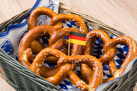 breadbasket: Breadbasket with traditional Bavarian pretzels with German flag.