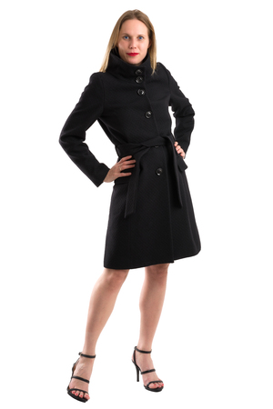 chic: Full body portrait of an attractive blonde woman posing in her black winter coat, isolated on white