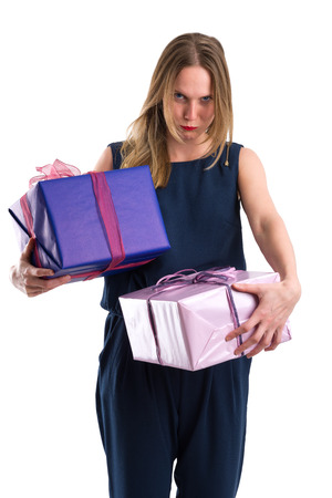 Disgruntled looking woman carrying heavy gift packages, isolated on white