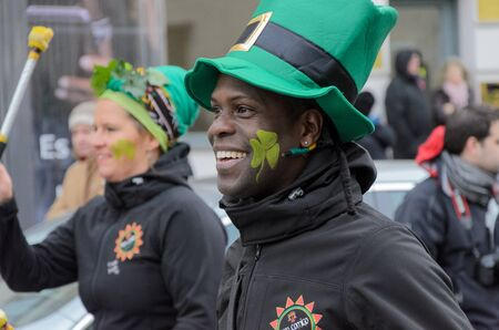 "MUNICH, BAVARIA, GERMANY -  MARCH 13, 2016: Drummers at the St. Patricks Day Parade. The name of the Afro-Brasil-Music-Band is"" VemComigo"". Close up on founder André Bispo dos Santos (""Tinga"")."