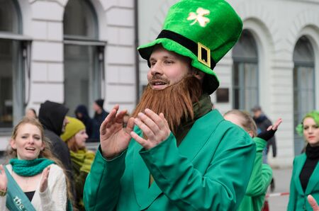 scottish culture: MUNICH, BAVARIA, GERMANY -  MARCH 13, 2016: Close up on man with red beard and green hat at the St. Patricks Day Parade.