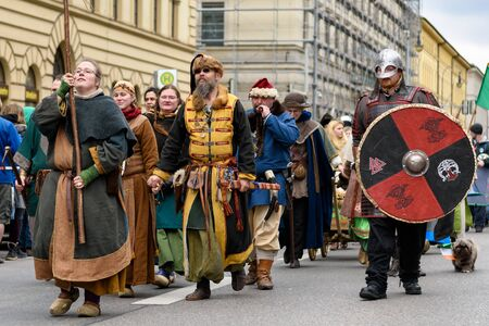 mongols: MUNICH, BAVARIA, GERMANY -  MARCH 13, 2016: group of men and women dressed up as Mongolian worriers of the Middle Ages at the St. Patricks Day Parade.