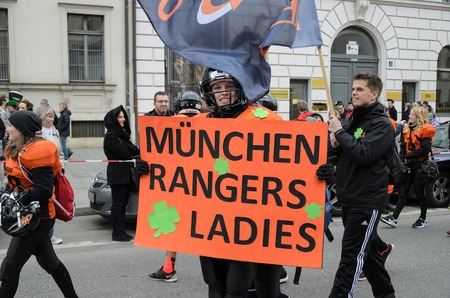 MUNICH, BAVARIA, GERMANY -  MARCH 13, 2016: close up on girl in American football clothes  representing the Munich Rangers Ladies at the St. Patrick's Day Parade.