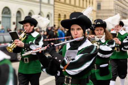 MUNICH, BAVARIA, GERMANY - MARCH 13, 2016: Flutists in clothes of the Middle Ages at the St. Patrick's Day Parade. The name of the band is Spielmannszug Gilching.
