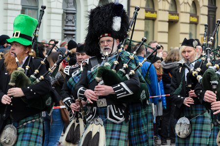 MUNICH, BAVARIA, GERMANY - MARCH 13, 2016: Bagpipers in traditional Scottish clothes at the St. Patrick's Day Parade. Editorial