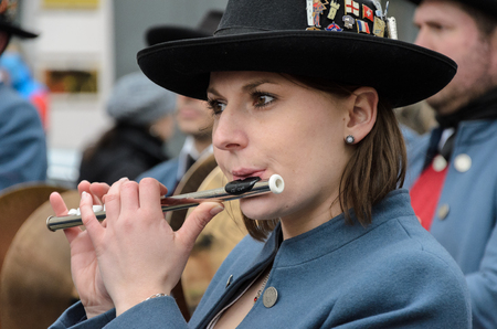 MUNICH, BAVARIA, GERMANY - MARCH 13, 2016: Close up on woman playing transverse flute at the St. Patrick's Day Parade.