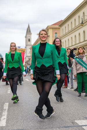 MUNICH, BAVARIA, GERMANY -  MARCH 11, 2018: group of girls representing the green emerald dancers at the St. Patrick's Day Parade.