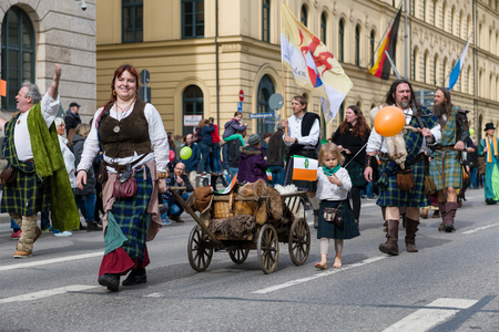 MUNICH, BAVARIA, GERMANY -  MARCH 11, 2018: People in clothes of the Middle Ages at the St. Patrick's Day Parade. Editöryel