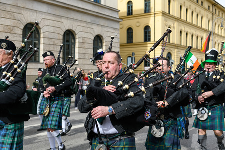MUNICH, BAVARIA, GERMANY -  MARCH 11, 2018: Bagpipers in traditional Scottish clothes at the St. Patrick's Day Parade.