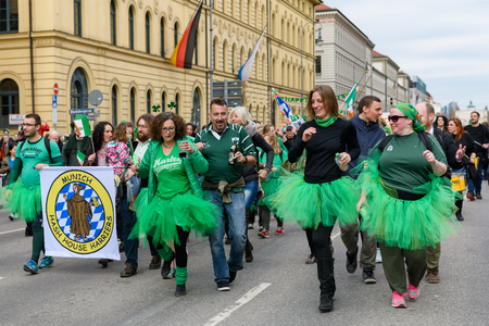 MUNICH, BAVARIA, GERMANY -  MARCH 11, 2018: group of people representing the Munich Hash House Harriers at the St. Patrick's Day Parade. Editöryel