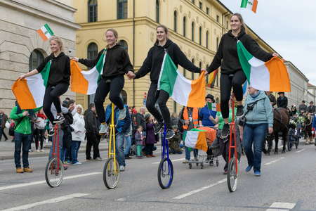 MUNICH, BAVARIA, GERMANY -  MARCH 11, 2018: group of girls on acrobatic unicycle at the St. Patricks Day Parade.