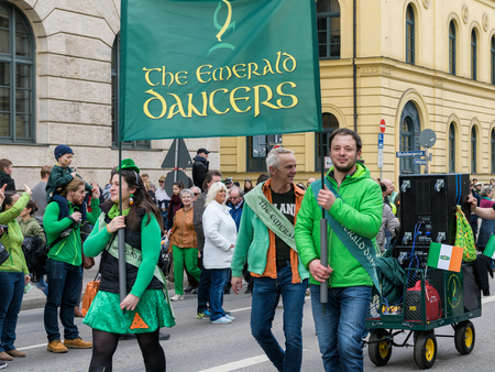 MUNICH, BAVARIA, GERMANY -  MARCH 11, 2018: group of people representing the green emerald dancers at the St. Patricks Day Parade.