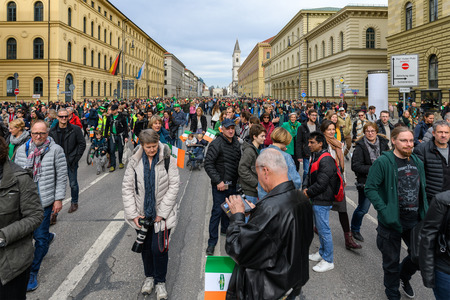 MUNICH, BAVARIA, GERMANY -  MARCH 11, 2018: Top down view on street, crowded with lots of people at the St. Patricks Day Parade.