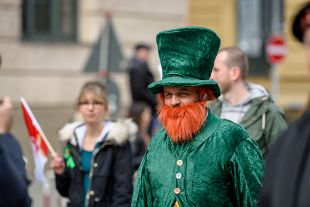 MUNICH, BAVARIA, GERMANY -  MARCH 11, 2018: Close up on man with red beard and green hat at the St. Patricks Day Parade. Editöryel