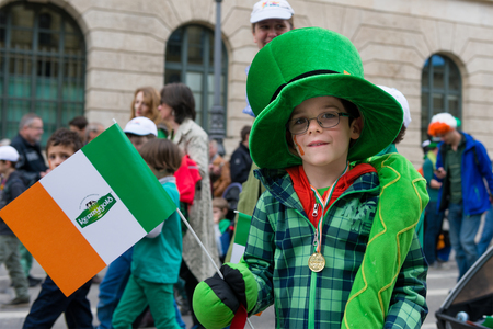 MUNICH, BAVARIA, GERMANY -  MARCH 11, 2018: close up on boy with big green hat at the St. Patricks Day Parade.