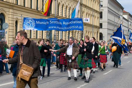 MUNICH, BAVARIA, GERMANY -  MARCH 11, 2018: Group of the Munich Scottisch Assoceation in traditional Scottish clothes at the St. Patricks Day Parade.