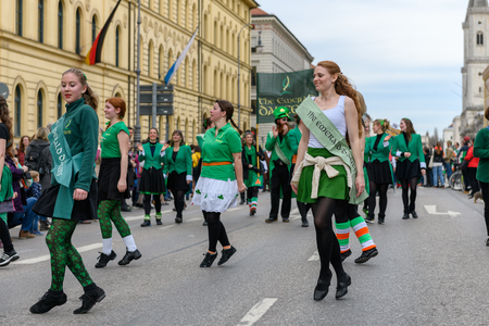 MUNICH, BAVARIA, GERMANY -  MARCH 11, 2018: group of girls representing the green emerald dancers at the St. Patricks Day Parade.