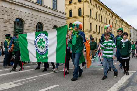 MUNICH, BAVARIA, GERMANY -  MARCH 11, 2018: group of the Munich Irish Rovers Football Club at the St. Patricks Day Parade.