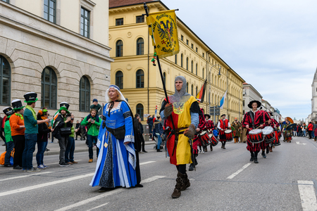 MUNICH, BAVARIA, GERMANY -  MARCH 11, 2018: People in clothes of the Middle Ages at the St. Patricks Day Parade. Name of the band is Kaiser Maximilian Trommler zu Kaufbeuren.