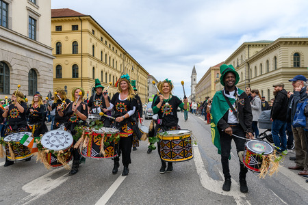 MUNICH, BAVARIA, GERMANY -  MARCH 11, 2018: Drummers at the St. Patricks Day Parade. The name of the Afro-Brasil-Music-Band is VemComigo. Founder Andre Bispo dos Santos Tinga walks in front. Editöryel
