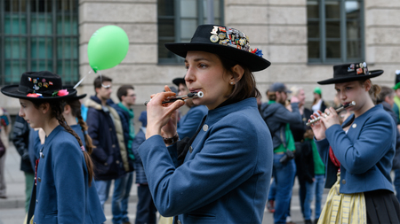 MUNICH, BAVARIA, GERMANY -  MARCH 11, 2018: Close up on woman playing transverse flute at the St. Patricks Day Parade. The name of the music band is Spielmannszug Ebersberg.