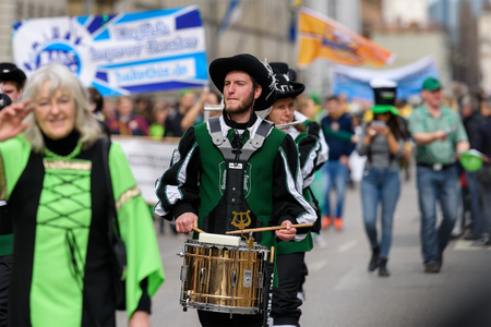 MUNICH, BAVARIA, GERMANY -  MARCH 11, 2018: Drummer and Flutists in clothes of the Middle Ages at the St. Patricks Day Parade. The name of the band is Spielmannszug Gilching.