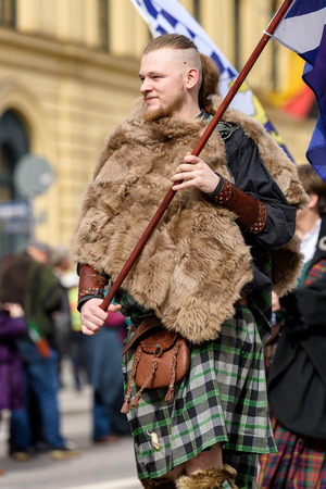 MUNICH, BAVARIA, GERMANY -  MARCH 11, 2018: Man in traditional Scottish clothes at the St. Patricks Day Parade.
