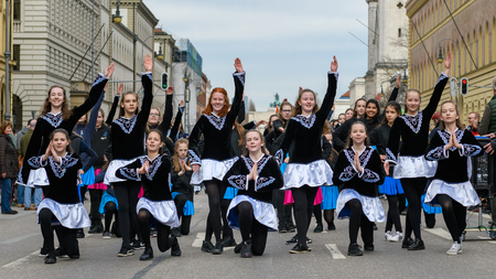 MUNICH, BAVARIA, GERMANY -  MARCH 11, 2018: group of girls representing the Celtic Colleens - Theresia Gerhardinger Gymnasium - at the St. Patricks Day Parade.