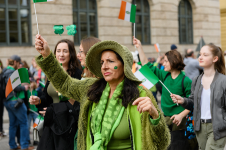 MUNICH, BAVARIA, GERMANY -  MARCH 11, 2018: Close up on group of masked people at the St. Patricks Day Parade.
