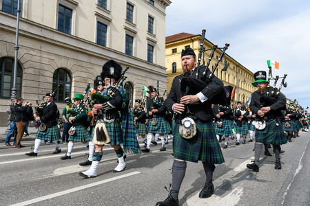 MUNICH, BAVARIA, GERMANY -  MARCH 11, 2018: Bagpipers in traditional Scottish clothes at the St. Patricks Day Parade.